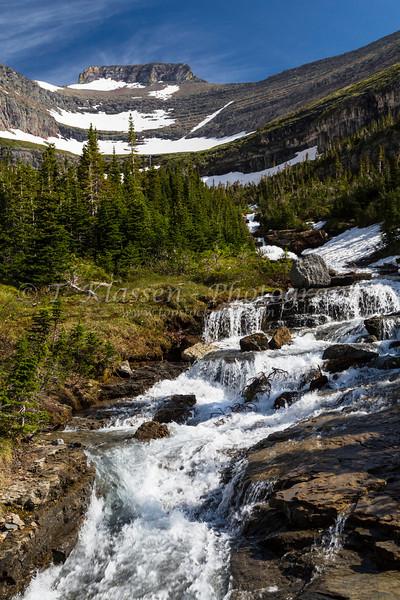 Alpine scenery and a waterfall near Logan Pass in Glacier National Park, Montana, USA.