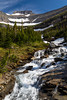 Alpine scenery and a waterfall near Logan Pass in Glacier National Park, Montana, USA.