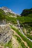 A mountain stream and waterfall near Logan Pass in Glacier National Park, Montana, USA.