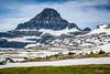 Alpine scenery with snow near Logan Pass in Glacier National Park, Montana, USA.