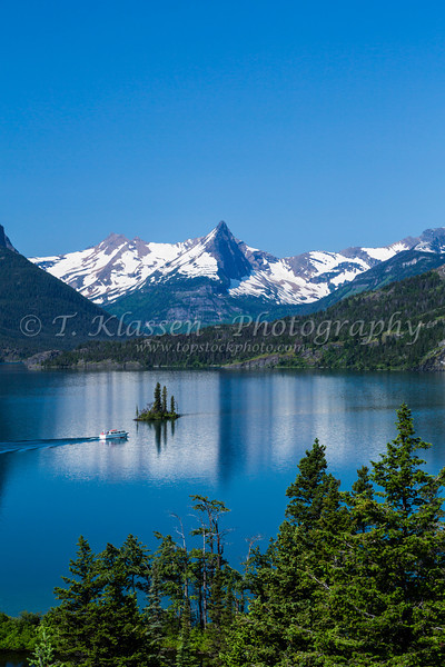 Lake St. Mary and Wild Goose Island with tour boat in Glacier National Park, Montana, USA.