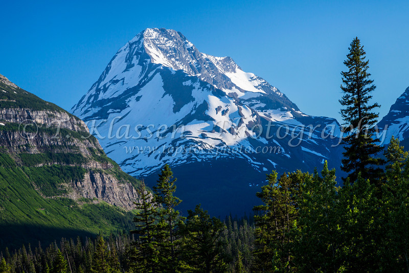 Alpine scenery with snow covered Mount Jackson near St. Mary Lake in Glacier National Park, Montana, USA.