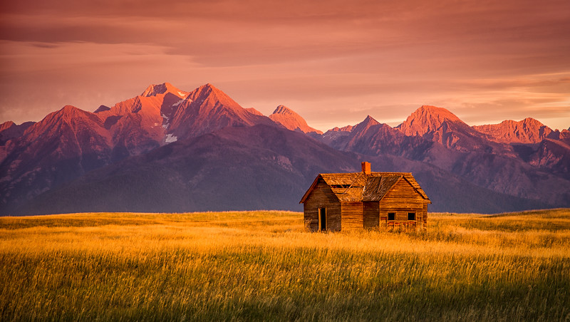 Mission Mountains abandoned house sunset