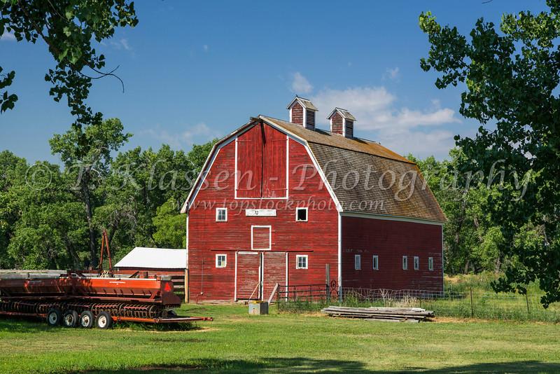 A red barn on a farm near Zurich, Montana, USA.