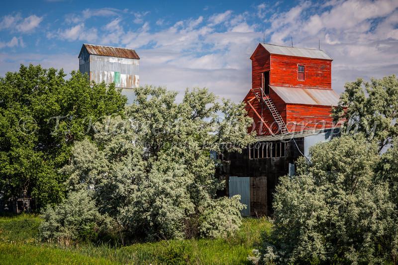 Two old abandoned grain elevators near Zurich, Montana, USA.