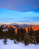 Sunrise/moonset as seen from Grizzly Peak in Custer National Forest on a windy winter morning. Captured with a Canon 5D III and 17-40/4.0L in aperture priority mode with an exposure bias of + 1/3 at ISO800, f/7.1, and 1/125th of a second. The camera was handheld.