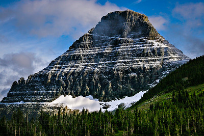 Evening light casts shadows on Reynolds Mountain above Logan's Pass in Glacier National Park.  Photo by Kyle Spradley | www.kspradleyphoto.com
