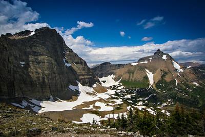 An alpine meadow sits below peaks at the Triple Divide Pass in Glacier National Park.  Photo by Kyle Spradley | www.kspradleyphoto.com