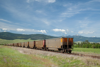 A train heads into the hills to the west of the National Bison Range.