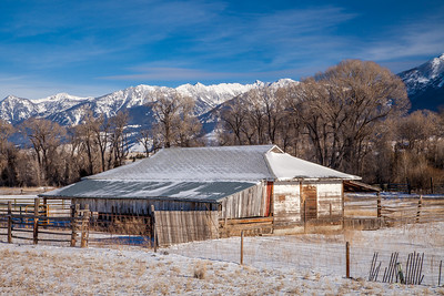 Old barn next to the Yellowstone River, Gallatin National Forest, with the Absaroka Mountains in the background.