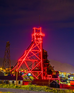"""""""Red Electric,"""" Butte Mining Headframes at Night; Butte, Montana"""