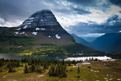 Afternoon light casts shadows through the clouds on Hidden Lake in Glacier National Park in Montana.  Photo by Kyle Spradley | www.kspradleyphoto.com