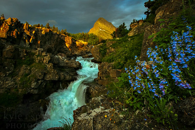 Morning light brightens Grinnel Point above Swiftcurrent Falls in the Many Glacier Area of Glacier National Park in Montana.  Photo by Kyle Spradley | www.kspradleyphoto.com