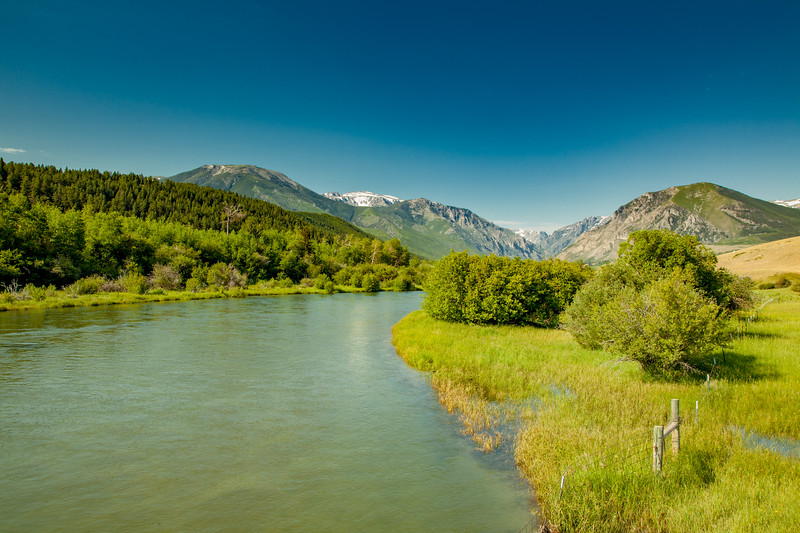 East Rosebud Creek as it flows north (left) from  the Beartooth Mountains out into the plains south of Roscoe, Montana.