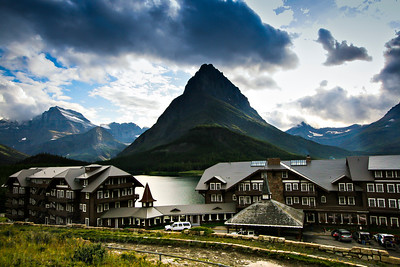 Peaks of the Garden Wall and Grinnel Point rise above Swiftcurrent Lake and the Many Glacier Lodge. The famous Swiss-style lodge is known for its old-world charm and elegant setting the alpine park.  Photo by Kyle Spradley | www.kspradleyphoto.com