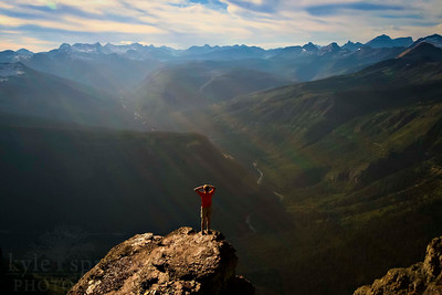 A hiker looks out from the peak of Mt. Oberlin to the Lake McDonald valley in Glacier National Park in Montana.  Photo by Kyle Spradley | www.kspradleyphoto.com