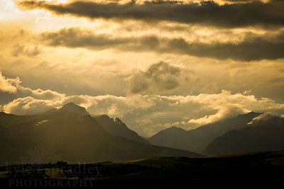 Viewed from Highway 89, evening light silouhettes mountain peaks outside Glacier National Park in Montana.  Photo by Kyle Spradley | www.kspradleyphoto.com