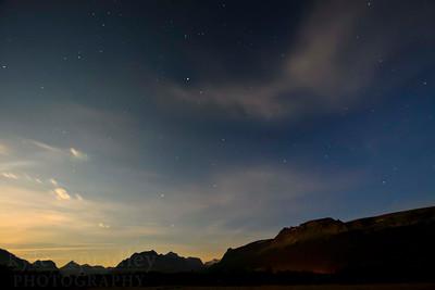Stars in the night sky above the peaks of Glacier National Park.  Photo by Kyle Spradley | www.kspradleyphoto.com