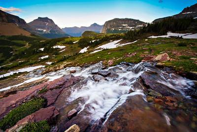 Reynolds Creek cascades down rocks in Logan's Pass in Glacier National Park.  Photo by Kyle Spradley | www.kspradleyphoto.com