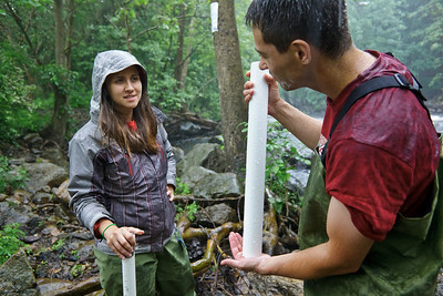 2011, CSAM, Rockaway River, Dr. Josh Galster and student Anita Trajkovska taking samples of sediment from the river bed.