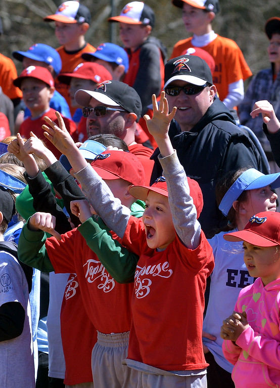 . (Bob Raines--Digital First Media)___ Players cheer for their favorite mascot racing around the bases at Hatfield-Towamencin Opening Day April 8, 2017.
