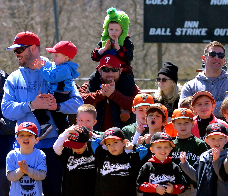 . (Bob Raines--Digital First Media)___ A lad sitting atop his father\'s shoulders to watch the festivities wears a Phantic at the opening day of the Hatfield-Towamencin Little League season April 8, 2017.