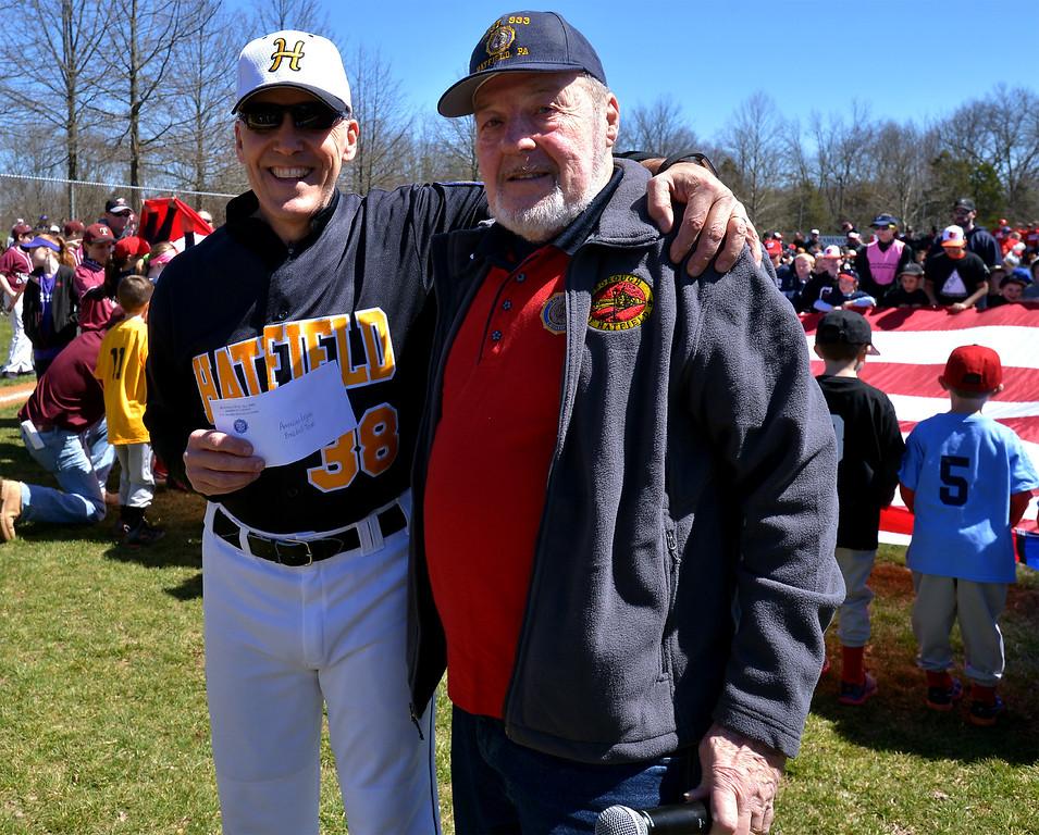 . (Bob Raines--Digital First Media)___ Bob Kaler, right, president of American Legion Post 933, present a check for $1000. to Jeff Klinger for the Hatfield-Towamencin Little League program on opening day April 8, 2017.
