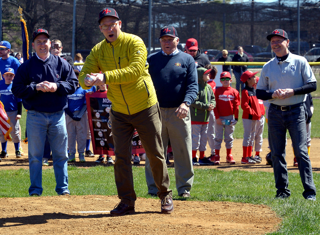 . (Bob Raines--Digital First Media)___ Lansdale Mayor G. Andrew Szekely throws the ceremonial first ball at the North Penn Little League Opening Day with backup pitchers Tom Zipfel, president of the Lansdale Board of Commissioners, PA Senator Bob Mensch, R-24th, and Hatfield Commissioner Bob Rodgers April 8, 2017.