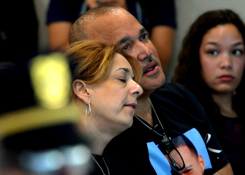 ". Linda and Robert Braxton, parents of murder victim Robert Braxton III, lean on each other during, \""Amazing Grace,\"" April 11, 2017.  (Bob Raines--Digital First Media)"