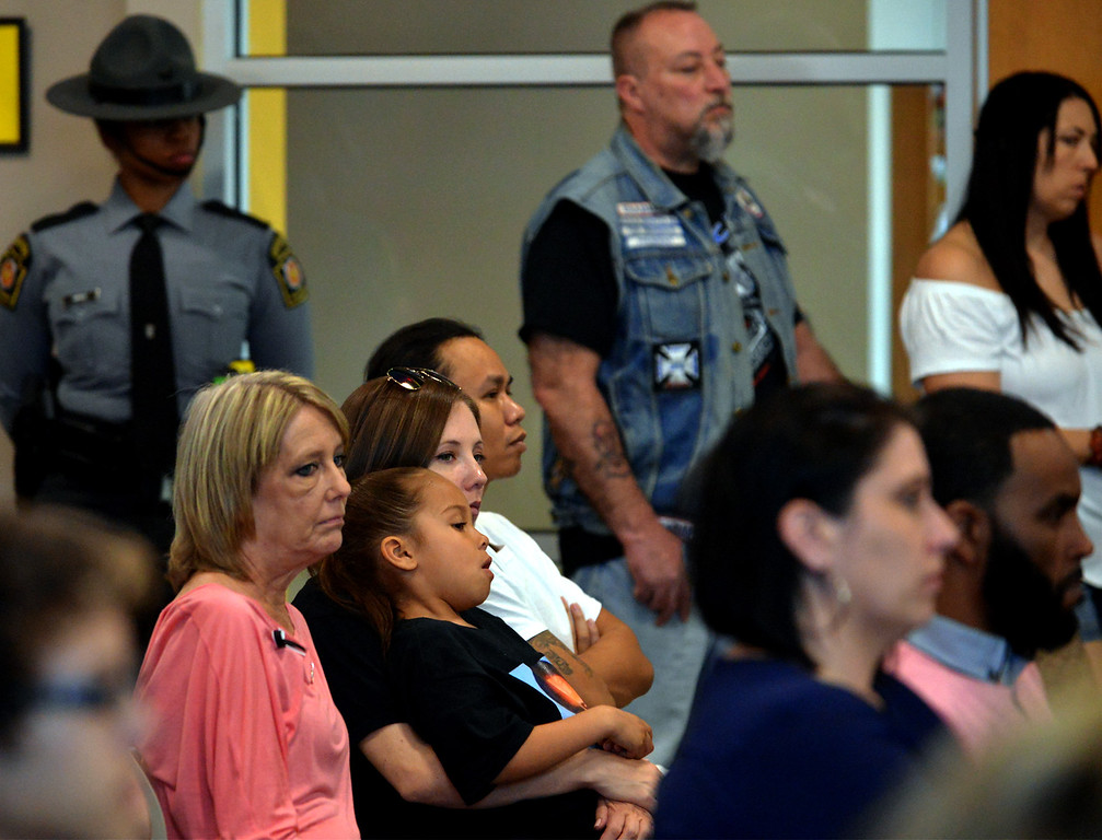 . Family and friends listen solemnly as the list of murder victims is read April 11, 2017.  (Bob Raines--Digital First Media)