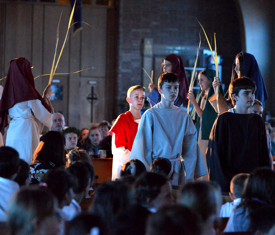 . Jesus and his followers enter Jerusalem acclaimed with wave palm fronds as seventh grade students re-enact the passion and death of Jesus in the sanctuary of St. Stanislaus Catholic Church April 12, 2017.  (Bob Raines / Digital First Media)