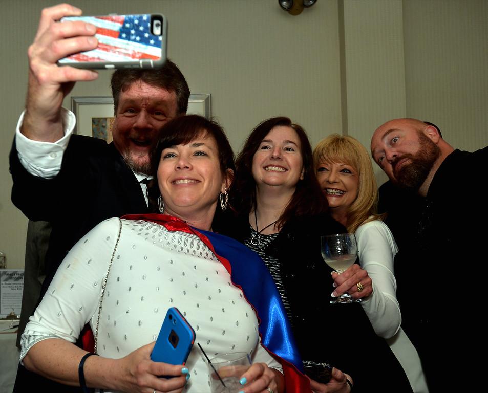 . Jim Garrahan takes a selfie of Superhero Theresa Schwartzer, Cheryl Gillmer, Tonja Garrahan and Greg Schwartzer at the North Penn UnitedWay Superheroes Unite Gala April 21, 2017.  (Bob Raines/Digital First Media)