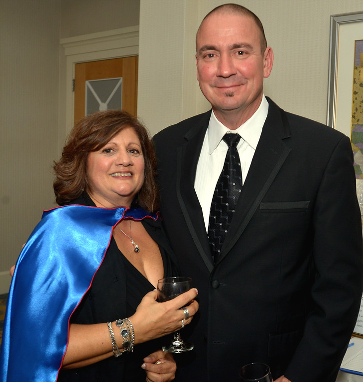 . Superhero Lisa Jones and Mike Jones enjoy themselves at the North Penn United Way Superheroes Unite Gala April 21, 2017.  (Bob Raines/Digital First Media)