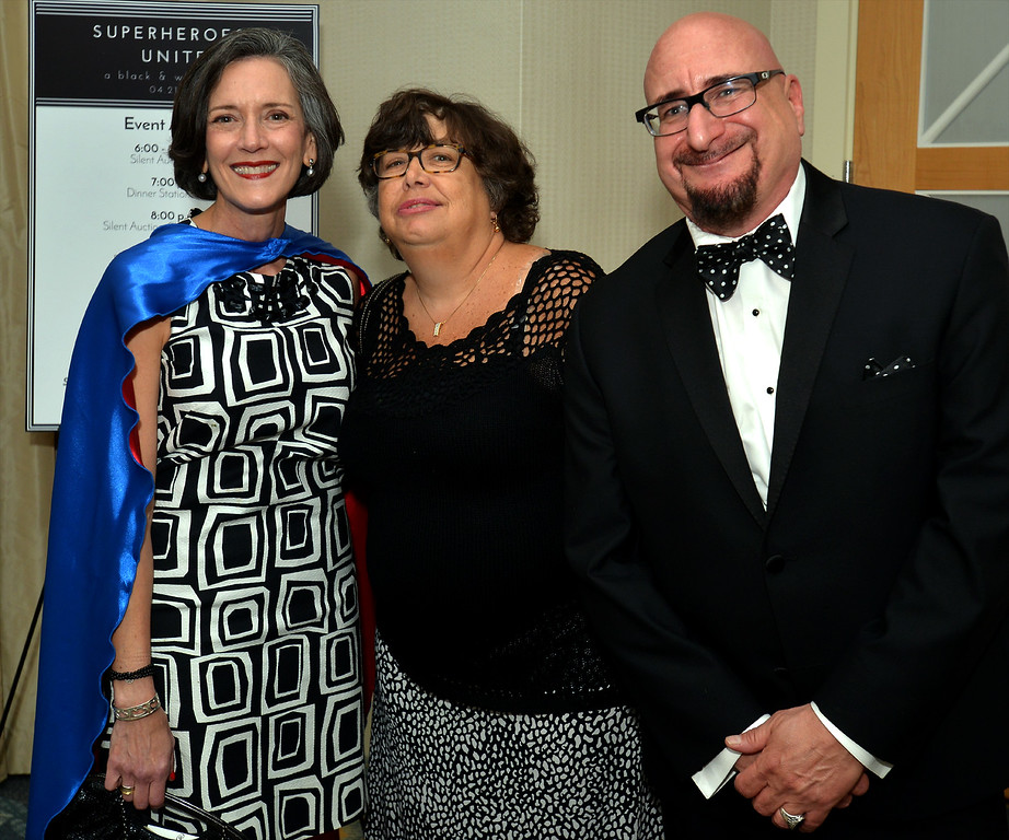 . Dr. Valerie Arkoosh, chair, Montgomery County Board of Commissioners, stands with Joanne Mahoney and Richard Buttacavoli at the North Penn United Way Superheroes Unite Gala April 21, 2017.  (Bob Raines/Digital First Media)