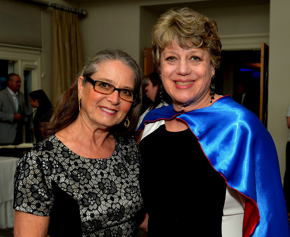 . Bob Raines--Digital First MediaMary Lou Fischer, left, accompanied her superhero sister, JoAnne Fischer, executive director, Maternity Care Coalition, to the North Penn United Way Superheroes Unite Gala April 21, 2017
