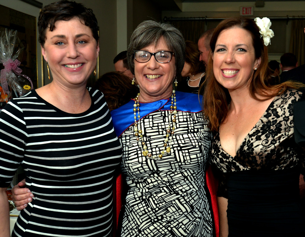 . Superhero Suzan Gould attends the North Penn United Way Superheroes Unite Gala with her daughter, Crystal Bianchi, left, and daughter-in-law, Elizabeth Gould April 21, 2017.  (Bob Raines/Digital First Media)