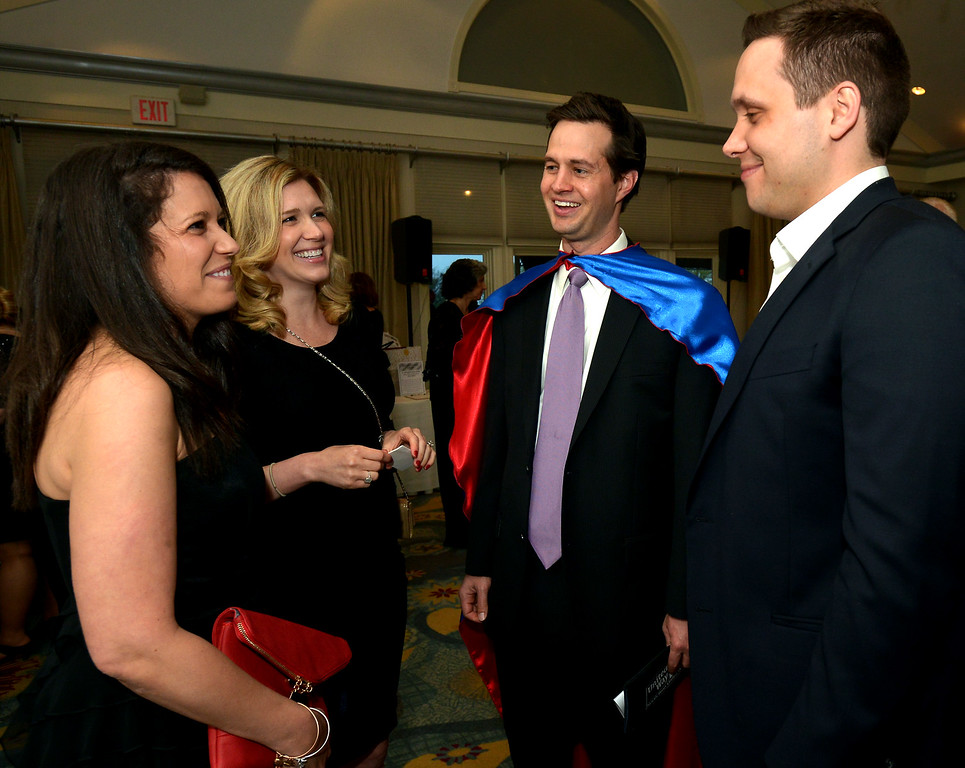 . Stephanie, left, and Chris Carey, right, chat with Superhero Brad Clemens and Andrea Clemens at the North Penn United Way Superheroes Unite Gala April 21, 2017.  (Bob Raines/Digital First Media)