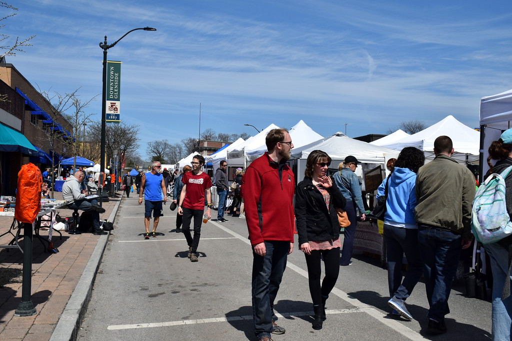 . Visitors explore the Downtown Glenside Arts Festival April 21. Debby High � For Digital First Media