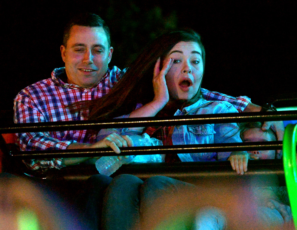 . A couple rides the Sizzler at the Upper Gwynedd Township Carnival Sept. 7, 2017. / Bob Raines--Digital First Media
