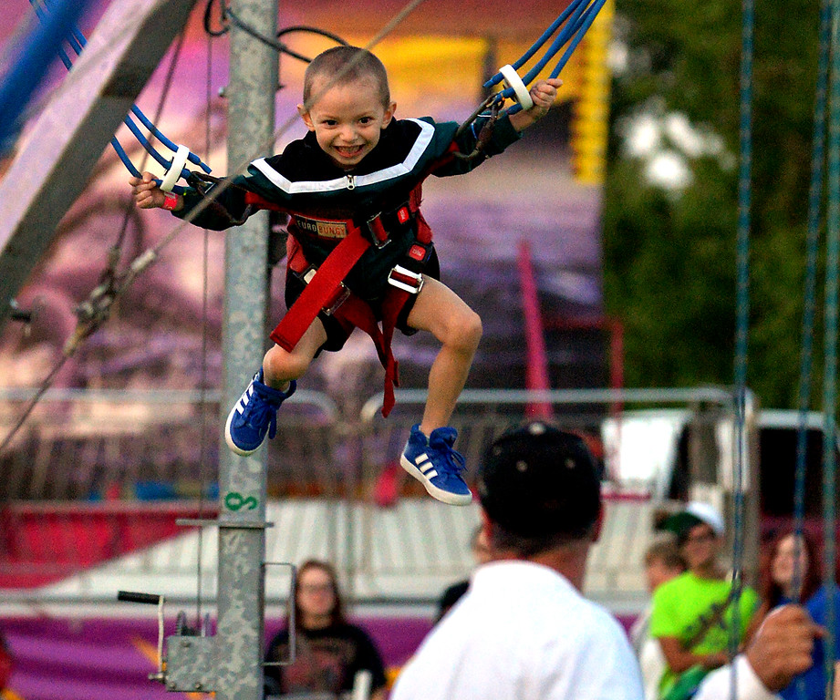 . Dominick Crowe has a great time bouncing on the bungee ride at the Upper Gwynedd Township Carnival  Sept. 7, 2017. / Bob Raines--Digital First Media