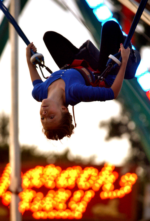 . Rylie Brooke does a few flips on the bungee cord ride at the Upper Gwynedd Township Carnival Sept. 7, 2017. / Bob Raines--Digital First Media