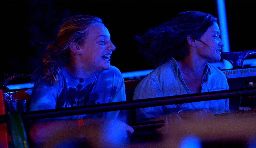 . Two girls ride the Sizzler at the Upper Gwynedd Township Carnival Sept. 7, 2017. / Bob Raines--Digital First Media