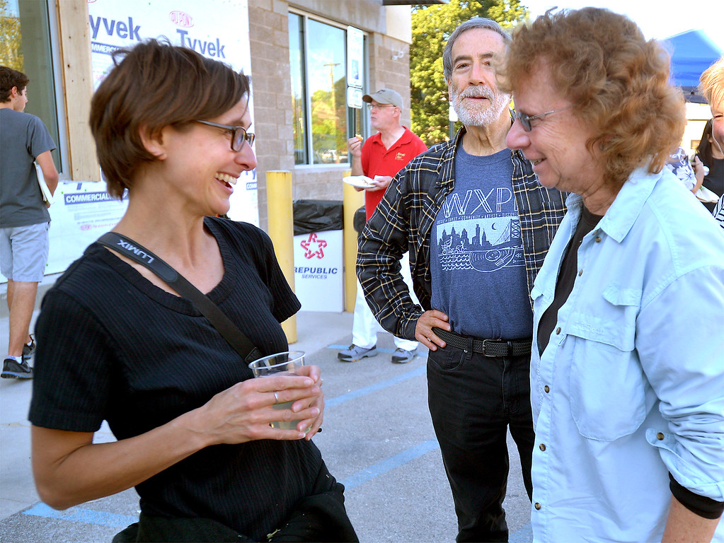 . Kathleen Casey, left, speaks with Bonnie Stone at the Weavers Way pre-opening event at the new Ambler location Sept. 8, 2017. / Bob Raines--Digital First Media