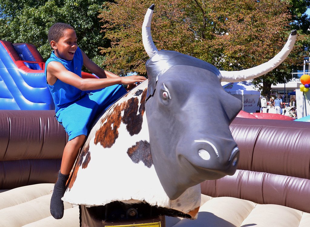 . Shien Walker loses his battle with the mechanical bull at the Whitpain Community Festival Sept. 23, 2017.Bob Raines--Digital First Media