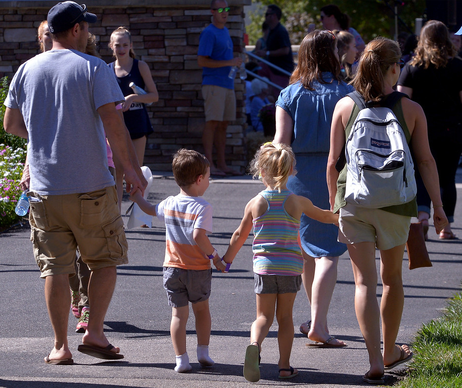 . A family walks hand-in-hand through the Whitpain Community Festival Sept. 23, 2017.Bob Raines--Digital First Media