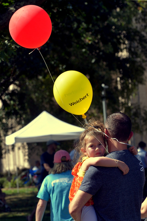 . Keith Drobnes carries a tired-looking Gabrielle Drobnes at the Whitpain Community Festival Sept. 23, 2017. / Bob Raines--Digital First Media