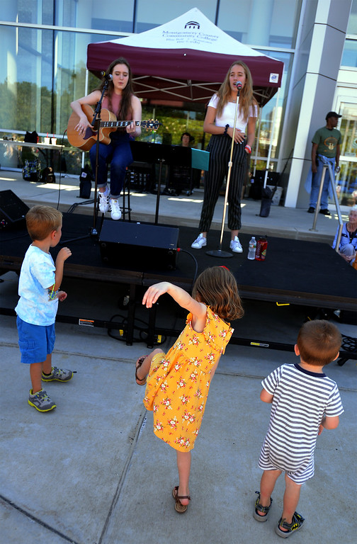 . Tommy Wzorek, Alexa Wintermantle and Kellan Wintermantle dance in front of Olivia Tyrrell and Ryan Stratton as they entertain at the Whitpain Community Festival Sept. 23, 2017. / Bob Raines--Digital First Media