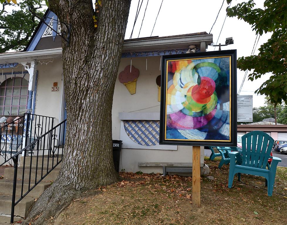 ". Bob Raines--Digital First Media\""Discs of Newton\"" by Frantisek Kupta stands in front of Dreams Ice Cream, E. Glenside Ave., Glenside Oct. 5, 2017."