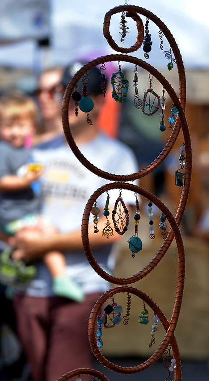 . A swirl of copper tubing adorned with bangles hangs on display at the Liz Steele Coats booth during the Ambler Oktoberfest Oct. 7, 2017. / Bob Raines--Digital First Media