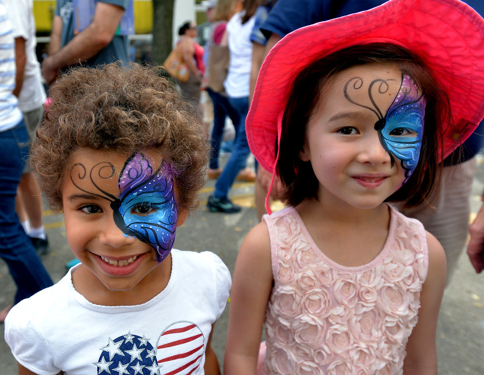 . Taylor Herd, left, and her friend, Violet Stone model their freshly painted faces at the Ambler Oktoberfest Oct. 7, 2017. / Bob Raines--Digital First Media